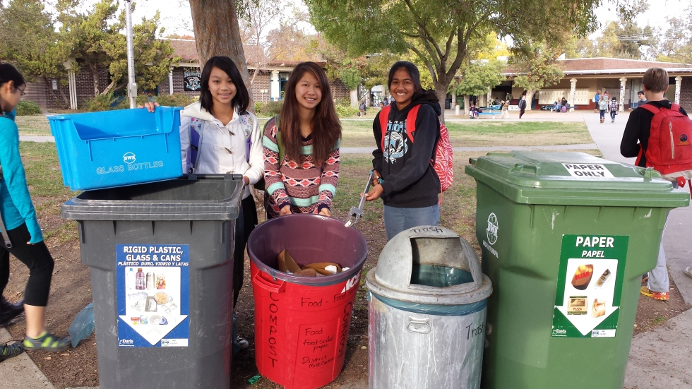 Holmes Junior High School students — from left, Abby Lo, MengZhen Larsen and Sithmi Jayasundara — help educate their classmates about how to recycle and compost their lunch waste. Courtesy photo